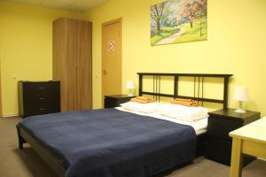 Кровать или кровати в номере Отель 55