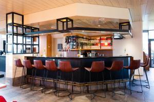 The lounge or bar area at Bastion Hotel Schiphol Hoofddorp