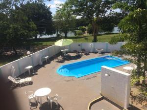Uma vista da piscina em Pousada Aguas de Ibira ou nos arredores