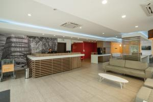 The lobby or reception area at Slim Bento Gonçalves