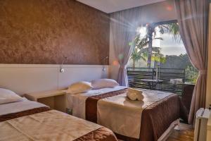 A bed or beds in a room at Pousada Bella Casa