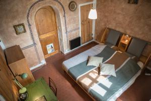 Een bed of bedden in een kamer bij Au Brabo