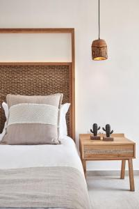 A bed or beds in a room at Volcano Luxury Suites Milos