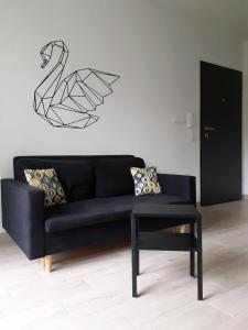 A seating area at Bedroom Apartments Bogusława