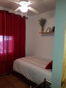 A bed or beds in a room at Villa el Gallo