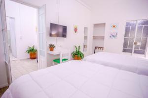 Cama o camas de una habitación en Casa Bruselas