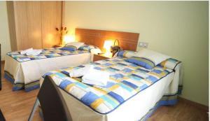 Cama o camas de una habitación en Pensión Palas