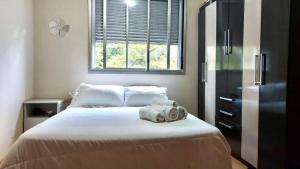 A bed or beds in a room at Residencial Araucária