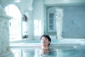 The swimming pool at or near Shinjuku Kuyakusho-mae Capsule Hotel