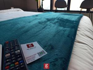 A bed or beds in a room at Ceylonz Suites KLCC by G Suites