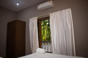 A bed or beds in a room at The Sovereign Villa