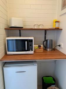 A kitchen or kitchenette at Warburton Motel