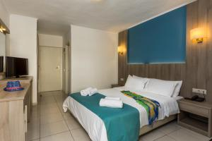 A bed or beds in a room at Central Hersonissos Hotel