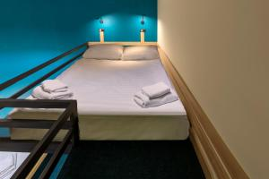 A bed or beds in a room at А.Kosterev Hotel Moscow