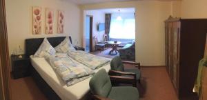 Ein Bett oder Betten in einem Zimmer der Unterkunft Landhaus Kappen