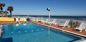 The swimming pool at or near Oceanfront Inn and Suites - Ormond