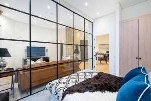 A television and/or entertainment center at Romantic luxury apartment in converted church, North London