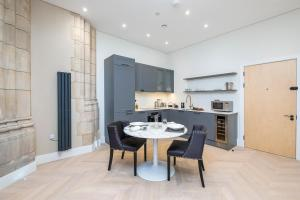 A kitchen or kitchenette at Romantic luxury apartment in converted church, North London