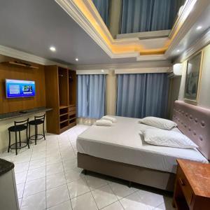 Cama ou camas em um quarto em Pousada Praiamar