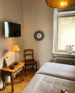 A bed or beds in a room at Ferienwohnung Dom- u. Regnitzblick