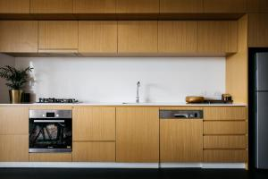 A kitchen or kitchenette at Nishi Apartments Eco Living by Ovolo