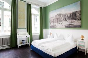 Ein Bett oder Betten in einem Zimmer der Unterkunft Hotel Columbia