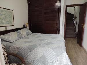 A bed or beds in a room at Quatre Saisons