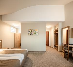 A bed or beds in a room at Hotel Kolping