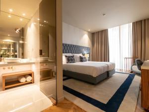 Uma cama ou camas num quarto em The Wine House Hotel - Quinta da Pacheca