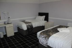 A bed or beds in a room at The Angel View Hotel