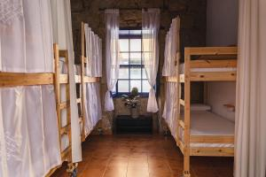 A bunk bed or bunk beds in a room at Ashavana Hostel