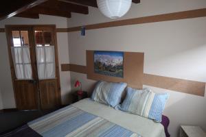 Una cama o camas en una habitación de Casa Andina Chaltén