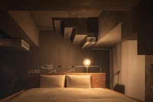 A bed or beds in a room at BnA WALL
