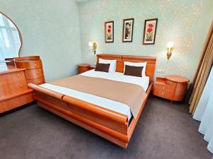 A bed or beds in a room at Hotel Avrora