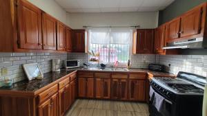 A kitchen or kitchenette at St Charles Inn