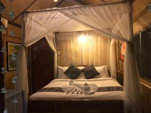 A bed or beds in a room at Viking Nature Resort