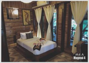 En eller flere senge i et værelse på Viking Nature Resort