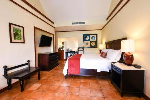 A bed or beds in a room at Tabacón Thermal Resort & Spa