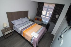 A bed or beds in a room at Hotel Los Inkas Huaraz
