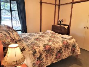 A bed or beds in a room at Currawong Farm Bed & Breakfast