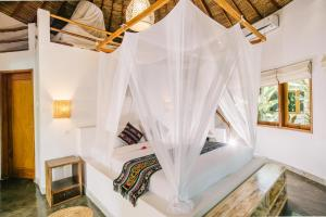 A bed or beds in a room at Mana Retreat