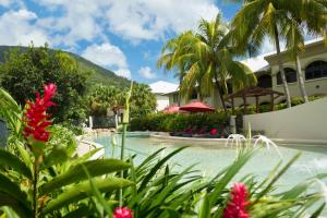 The swimming pool at or near Mango Lagoon Resort & Wellness Spa