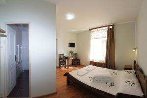 A bed or beds in a room at Casa Oana