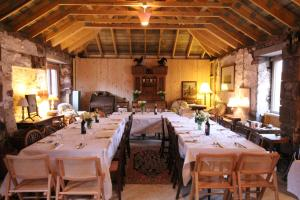 A restaurant or other place to eat at Meikle Kenny Farmhouse