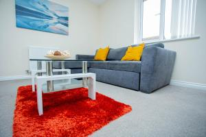 A seating area at Fruition City Apartments - Coventry