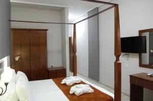 Ένα ή περισσότερα κρεβάτια σε δωμάτιο στο Paralia Beach Boutique Hotel