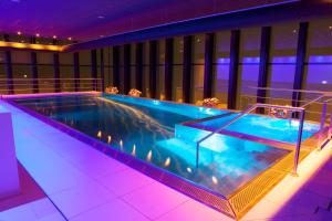 The swimming pool at or near Fletcher Wellness-Hotel Leiden