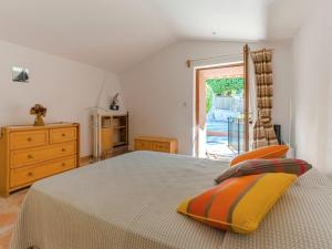 A bed or beds in a room at Pretty Holiday Home in Berre-les-Alpes with Garden