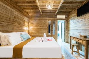 A bed or beds in a room at Road Beach Premier