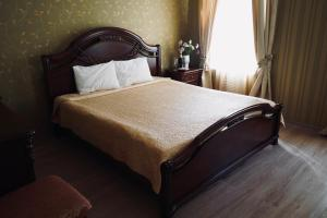 A bed or beds in a room at Evropeyskiy